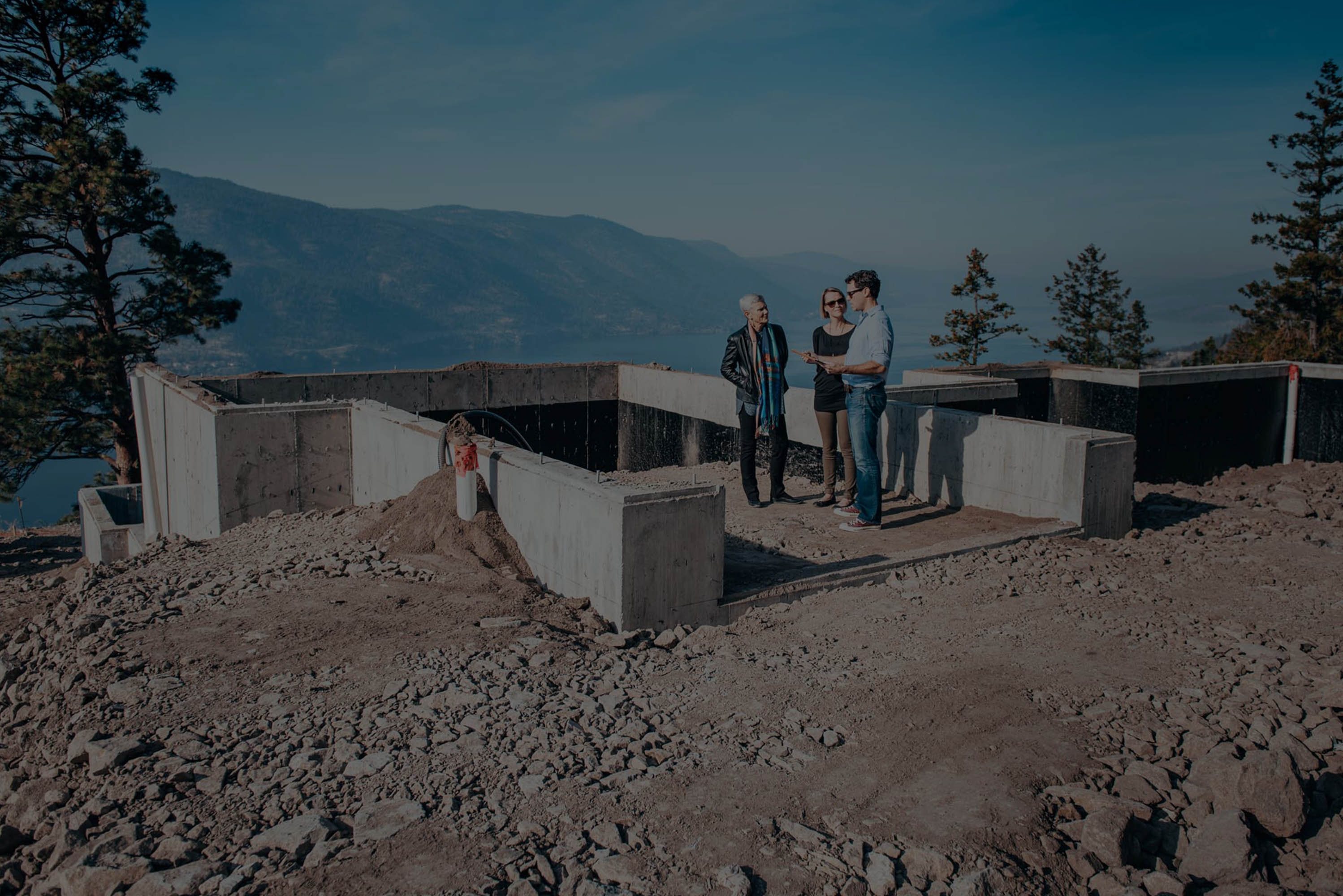 michael huber with clients at build site okanagan lake