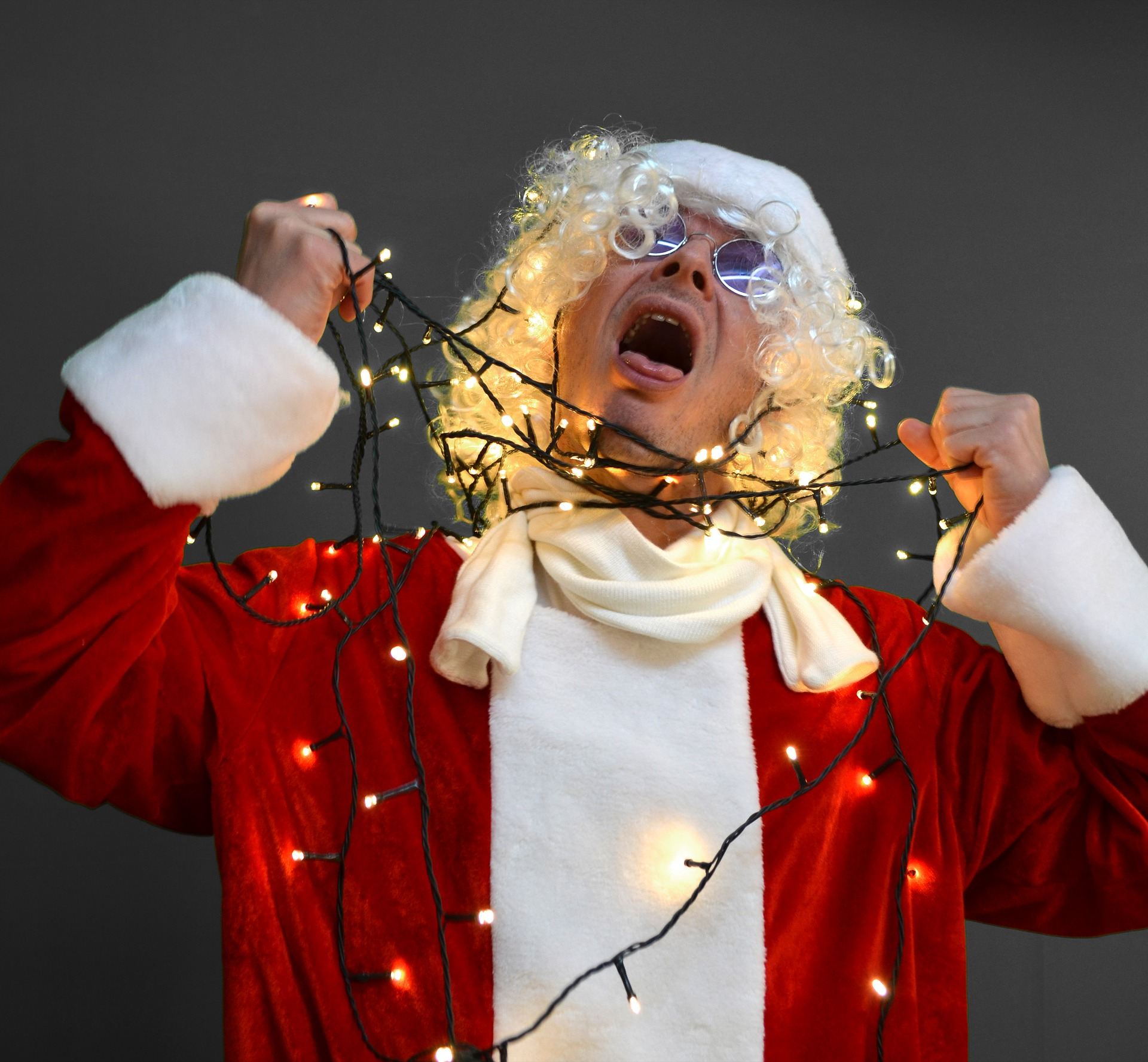 santa claus strangling himself wth christmas lights society