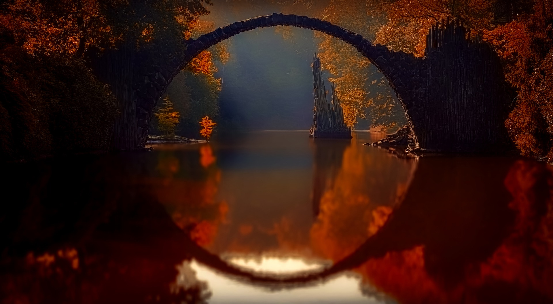beautiful photo of bridge over calm water perfect reflection autumn