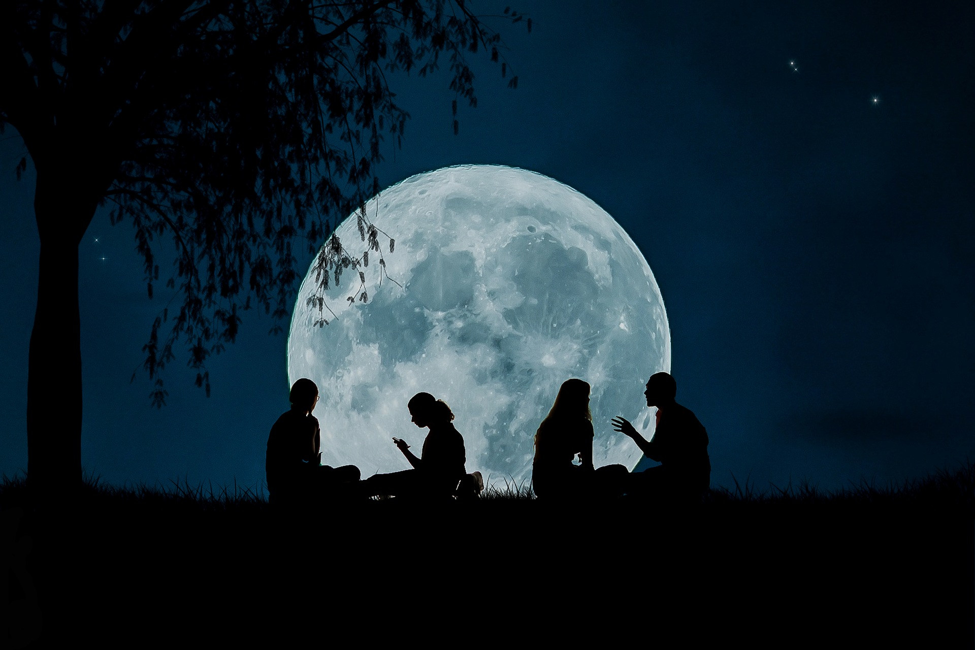 Night image of huge full moon with people observing
