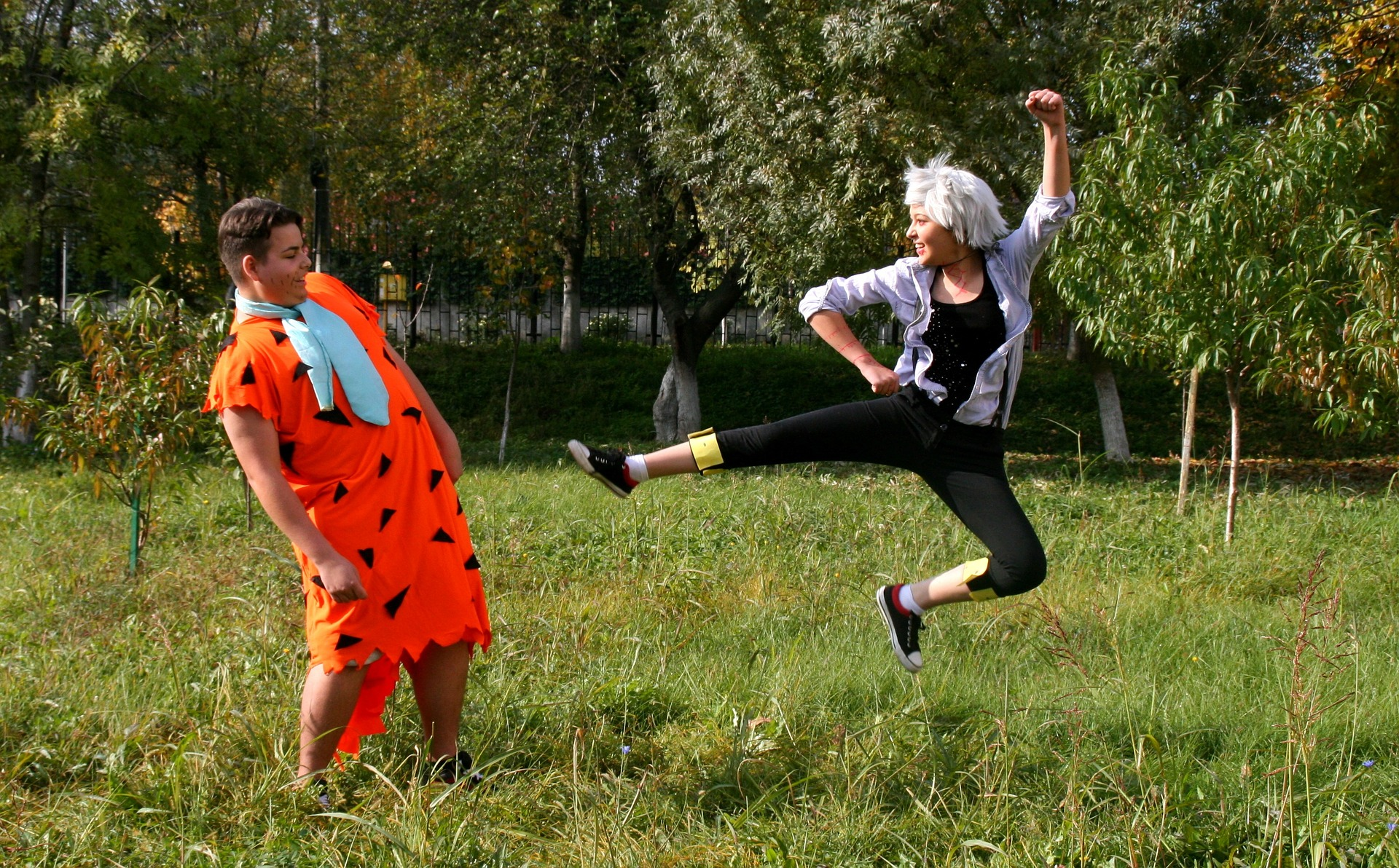 people dressed as fred and wilma flintstone