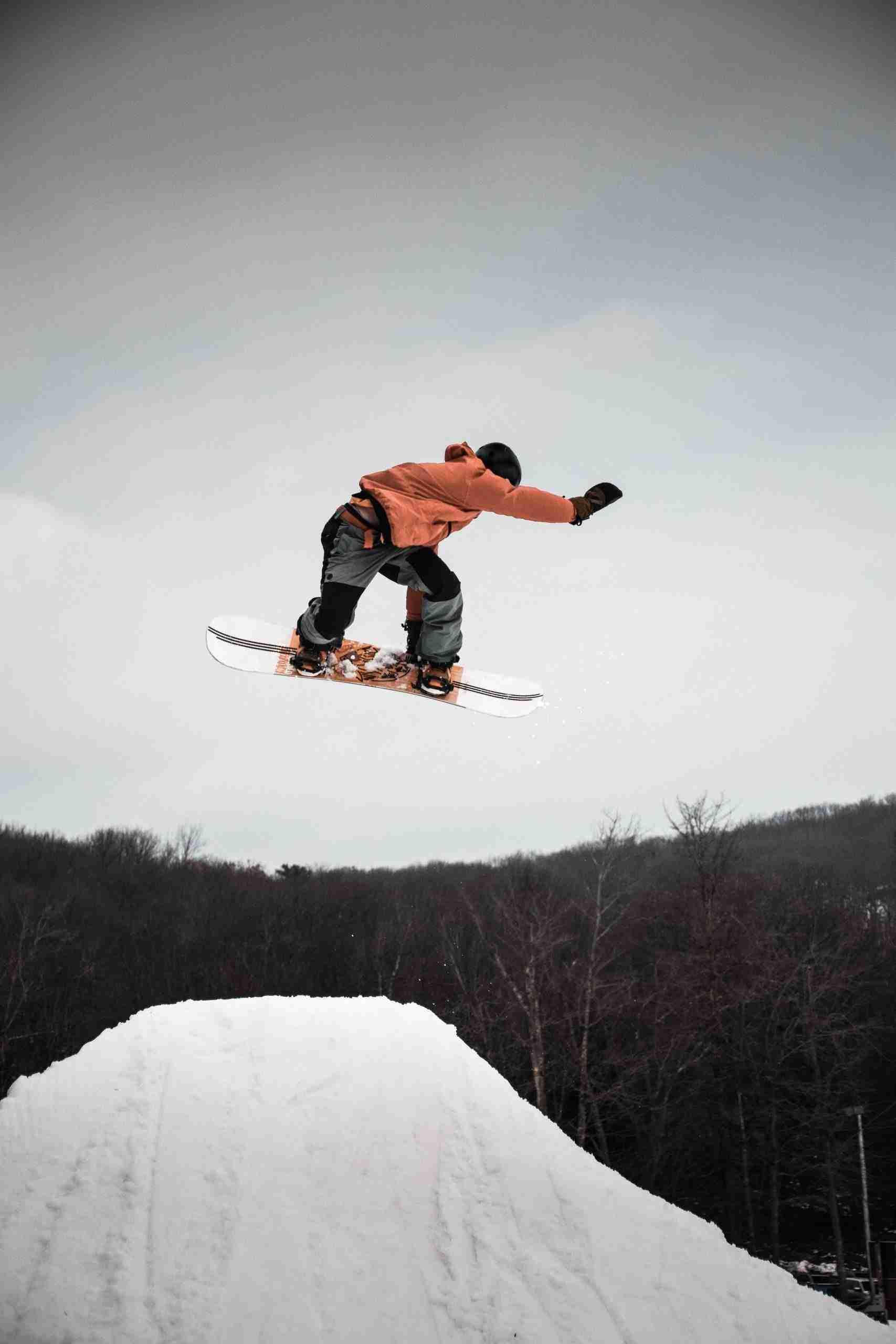 snowboarder flip winter downhill scene kelowna